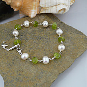 SOLD Bracelet Peridot Nugget Cultured Pearl and Sterling Silver With Charm
