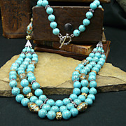 Triple Strand Turquoise,  Sterling Silver,  and Brass Accented Necklace
