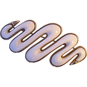 Monet White Thermoset in Gold tone Squiggle Brooch