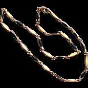 Vintage elongated enamel filled metal chain necklace