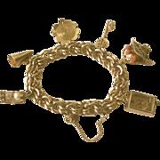 SALE Fabulous Gold Filled Vintage Charm Bracelet With 6  3 D Charms 1950's era!