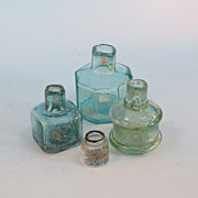 A group of 4 interesting inkwells!