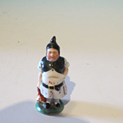 Colorful hand-painted porcelain butcher holding a ham