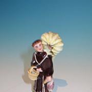 Porcelain figure of a Monk holding a basket & a game bird