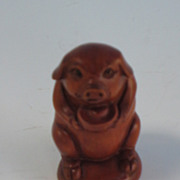 A Netsuke in the form of a seated pig