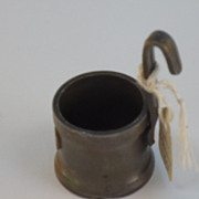 A miniature Pewter measure