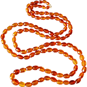 REDUCED Art Deco 45 inch faceted real amber bead necklace