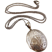 Antique Victorian sterling silver back and front locket on 24 inch sterling chain