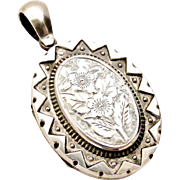 Victorian sterling silver 'back and front' locket in superb condition.