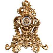 A 19th Century French Gilt Bronze Figural Mantle Clock