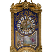 A 19th Century French Sevres Porcelain & Gilt-Bronze Figural Eight-Day Mantle Clock