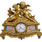 A French Gilt Bronze Porcelain Figural Clock Depicting Lovers.