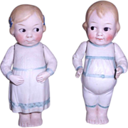 SOLD Adorable Small Pair of Googlies with Molded Clothes