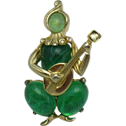 Early CORO CRAFT Corocraft Figural Flawed Emerald Glass Cabochon Musician Rare