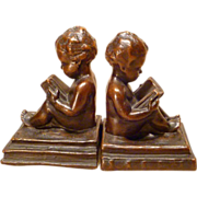 """SOLD 1920s Bookends """"Young Wisdom"""" Nude Baby with Books"""