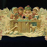 REDUCED c1890s Die Cut Calendar Top, Victorian Girls with Doll at Snowy Fence