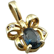 Golden Bow and Midnight Sapphire: Small Pendant