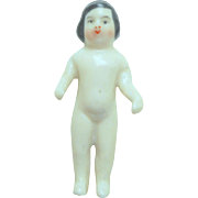 Pink Tint Frozen Charlotte Doll Side Parting c1880
