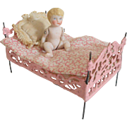 Pink Painted Soft Metal Bed & Doll c1910