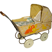 Delightful old miniature tin doll pram