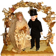 Charming bisque head dolls wedding couple with wax circlet