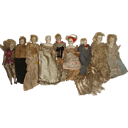 Family of 9 early dolls house dolls