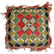 Colourful old beaded pin cushion
