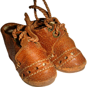 Pair of small leather brown doll shoes