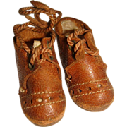 Small pair of brown lace up doll shoe
