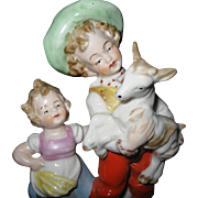 SALE Vintage, German Hand-Painted Porcelain Figurine, Young Girl, with Boy, holding a baby Goa