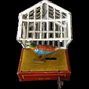 GERMAN TIN WINDUP PENNY BIRD IN CAGE c. 1900