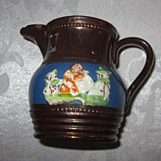 Copper Lustre Pitcher with Raised Figural Decoration, English