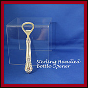 Web bottle opener with sterling handle