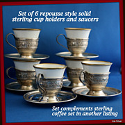 Demitasse cup holders in solid sterling repousse style and solid sterling saucers