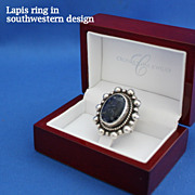 Lapis lazuli ring in southwestern design encircled by sterling silver
