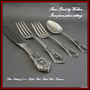 Rose Point four-piece place setting of sterling by Wallace