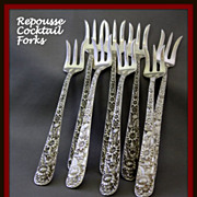 Repousse Sterling cocktail forks by Samuel Kirk