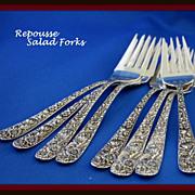 Repousse sterling salad forks by Samuel Kirk