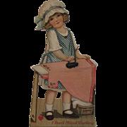 German Mechanical Valentine Girl Ironing a Pink Dress
