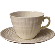 Belleek Limpet Yellow Lustre Teacup and Saucer