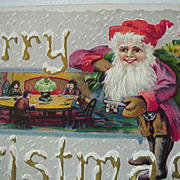 Merry Christmas Postcard Girl Dressed As Santa With Flag In Toy Bag