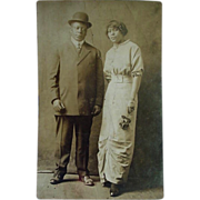 SOLD Black Americana RPPC Postcard Well Dressed Couple She is Holding Purse