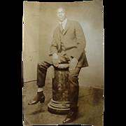 SOLD Black Americana Rppc Real Photo Postcard Man Sitting On Flower Pedestal