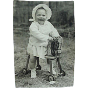 Toddler On Push Along Toy Horse Photo Photograph