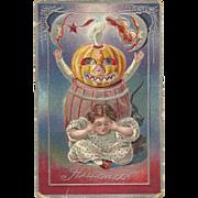 Nash Halloween Series No 5 Girl and Pumpkin Head in barrell Moon vintage postcard