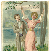 SOLD Romantic vintage postcard woman being pushed on swing