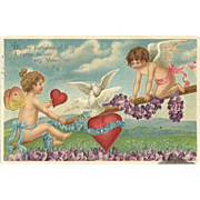 SOLD Cupid and fairy teeter totter on Love Vintage Valentine Postcard