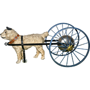 SOLD 19th Century Fuzzy Terrier Dog on Wheels Bell Toy Glass Eyes Collar Harness
