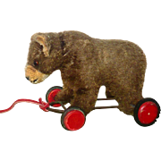 SOLD Vintage 6 Inch Brown Mohair Pull Toy Standing Bear on Red Wood Wheels Hump Amber Eyes Wea