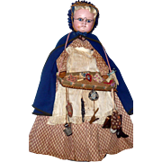 19th Century 21 Inch Wax Over Composition Peddler Woman Doll Basket Wares Cloak Woven Straw Bo